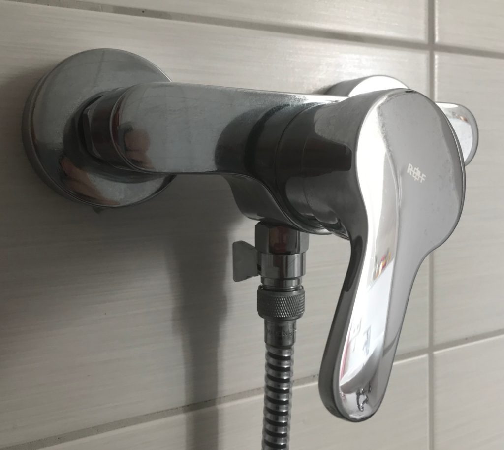bathroom shower water tap with flow reduction valve